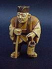 Japanese Ivory Netsuke Man with lantern artist signed