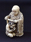 Japanese Ivory Netsuke Buddha and Oni artist signed